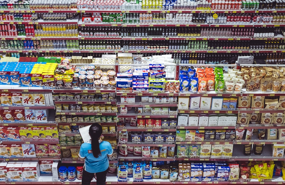 store worker stacking shelves