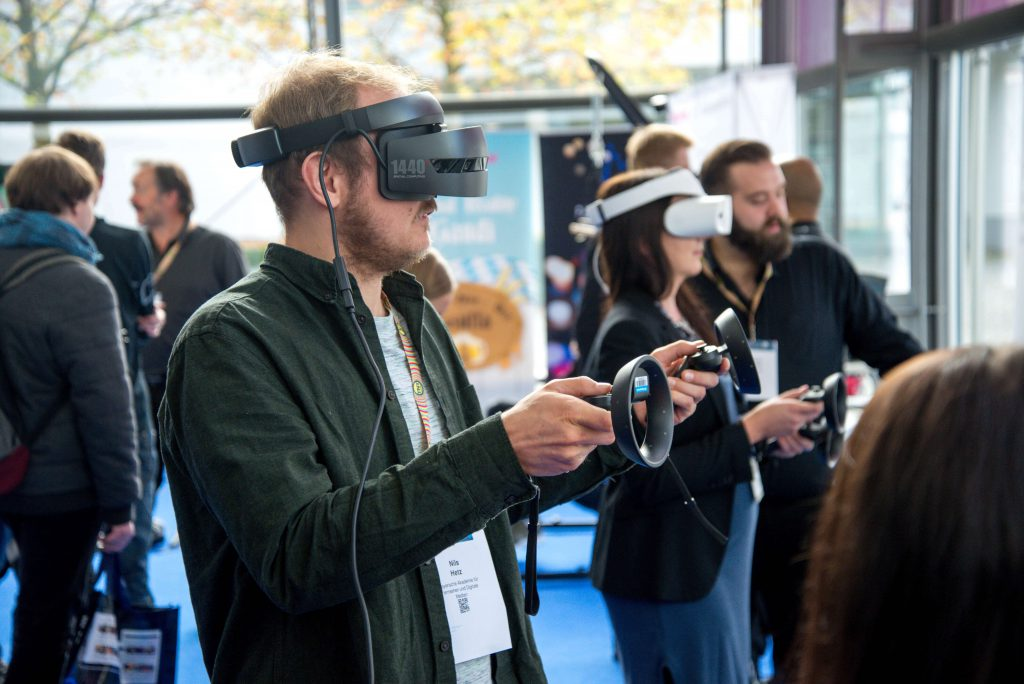 Man using virtual reality recruitment tools at an open day